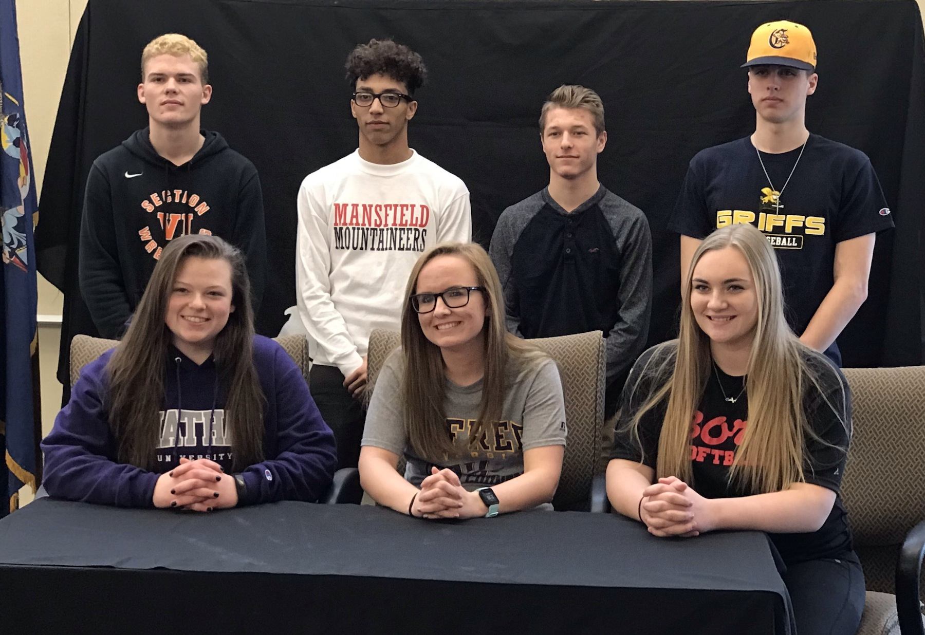 The seven seniors who sign to extend their athletic careers into college. From left, back row, Josh Thibeault, Jordan Parks, Nick Stott and Tom Peltier. Front row, Selena Justus, Mackenzie Grosskopf and Mackenzie Quider. (Photos by David Yarger)