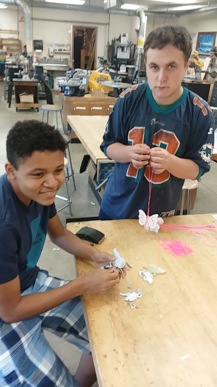 Aaron Tanger and Zach Simmons make butterflies for their fundraiser for the BCNWNY.