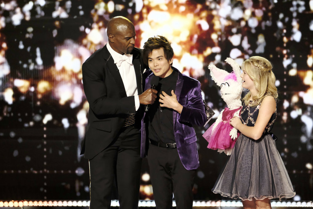 Shin Lim won the first season of `America's Got Talent: The Champions,` defeating runner-up Darci Lynne. They're pictured alongside host Terry Crews. (NBC photo by Trae Patton)
