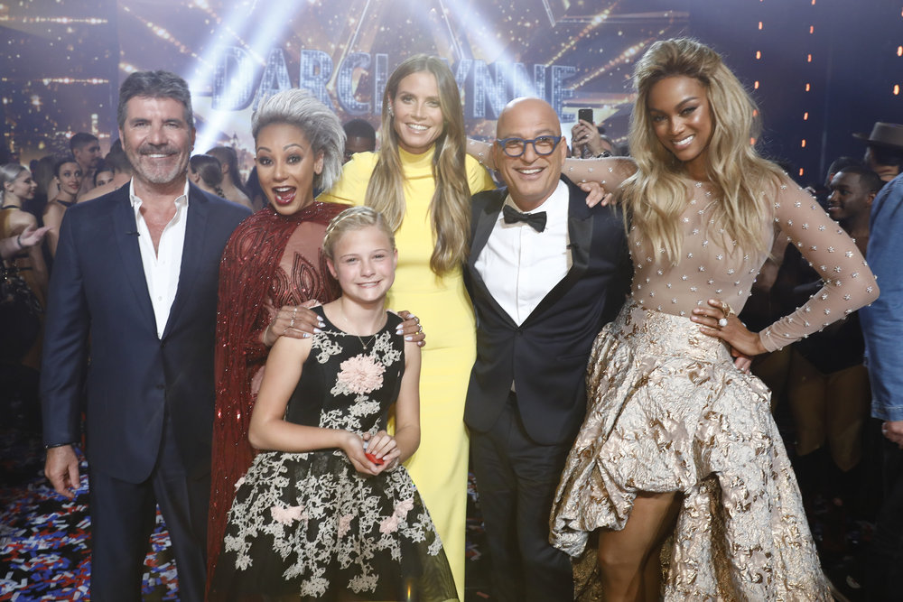 Pictured with Darci Lynn are, from left, `AGT` judges Simon Cowell, Mel B, Heidi Klum and Howie Mandel, and host Tyra Banks. (NBC photo)