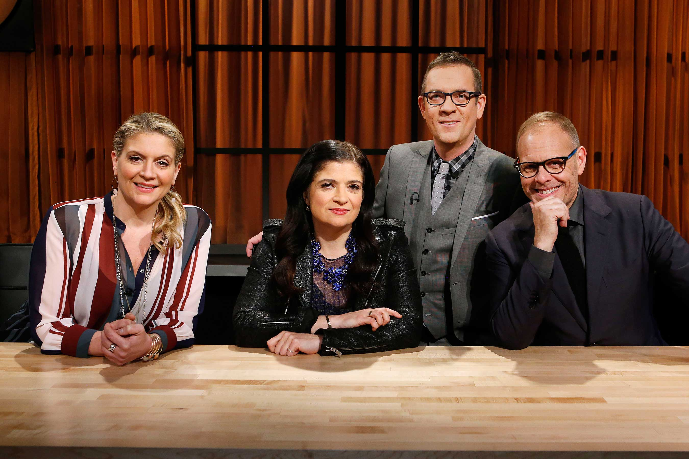 Pictured are `Chopped: Alton's Challenge` judges Amanda Freitag, Alex Guarnaschelli and Alton Brown, with host Ted Allen. (Food Network photo)