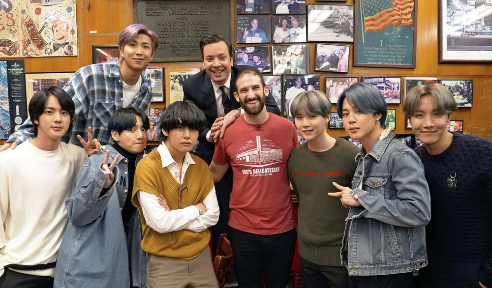 `The Tonight Show Starring Jimmy Fallon` ...  and, for one night, BTS, too. Pictured: (top row, from left) RM, Fallon, (bottom row, from left) Jin, Jungkook, V, a Katz Deli employee, SUGA, Jimin, and J-Hope of BTS. (NBC photo by Andrew Lipovsky)