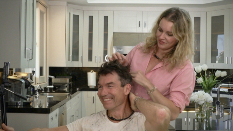 `Haircut Night In America,` hosted by Jerry O'Connell and Rebecca Romijn, is scheduled to air May 29. (Screen Grab/CBS ©2020 CBS Broadcasting Inc. All rights reserved.)