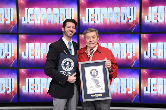 Johnny Gilbert receives his Guinness World Records award. (Photo courtesy of Jeopardy Productions Inc.)