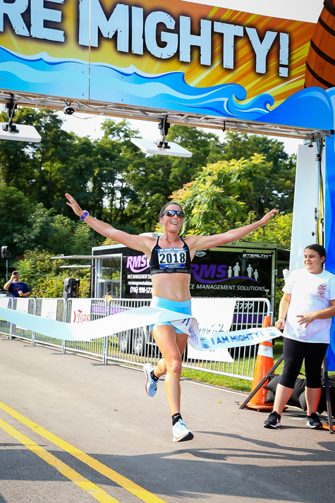 Mighty Niagara Half Marathon winner Allie Kieffer of Williamsville crosses the finish line with a time of one hour and 14 minutes. (Submitted)
