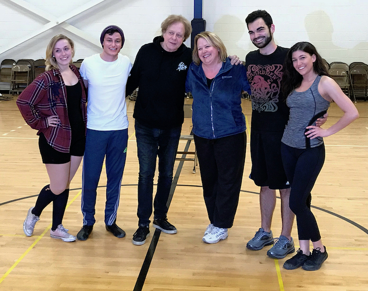 `Two Tickets to Paradise: The Musical,` a stage version of rock star Eddie Money's life story, features Niagara University alumni Heather Casseri, Matthew Dell'Olio, Matthew Divita, Shelby Ehrenreich and Peter Raimondo, and associate professor Terri Filips Vaughan. Pictured at a rehearsal are, from left, Casseri, Raimondo, Money, Vaughan, Divita and Ehrenreich.