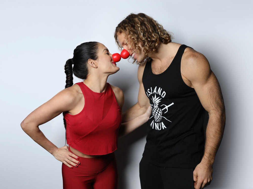 `American Ninja Warrior` athletes -- with their red noses: Nikki Bella and Grant McCartney. (NBC photo by Tyler Golden)