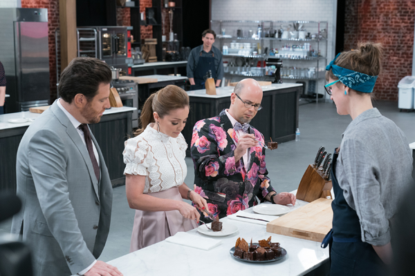 Scott Conant, Marcela Valladolid and Jason Smith check in on Becca Craig on Food Network's `Best Baker in America.` (Food Network photo)