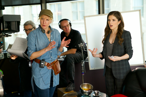 Director Trish Sie, left, and Anna Kendrick as Beca on the set of `Pitch Perfect 3,` the follow-up to summer 2015's blockbuster hit that took the honor of highest-grossing live-action movie-musical opening of all time. (Photo credit: Quantrell D. Colbert)