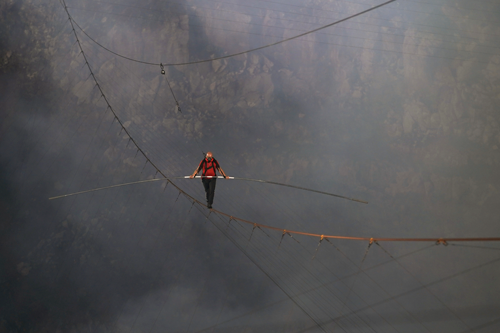 Nik Wallenda walks above the mighty Masaya volcano in Nicaragua on ABC's `Volcano Live! with Nik Wallenda.` (ABC photo by Jeff Daly)