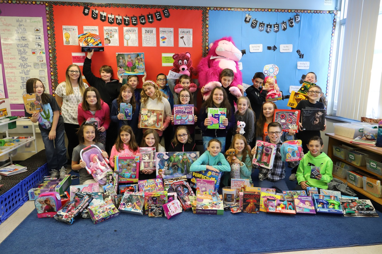 Student teacher Jessica Pulaski and students with their donations to the Roswell Park Cancer Institute.