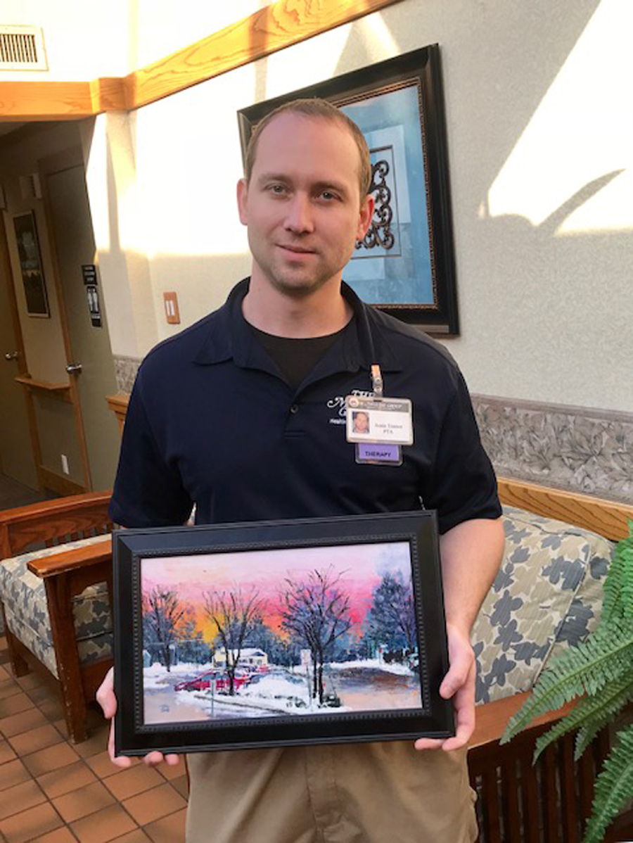 Justin Trainor is pictured holding a photo that depicts the scene as you pull out of Northgate's driveway.