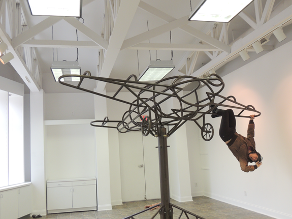 Aerial-actor Mara Neimanis rehearses `Air Heart` in the Artpark Gallery. The sculpture is by Tim Scofield. (Submitted photo)