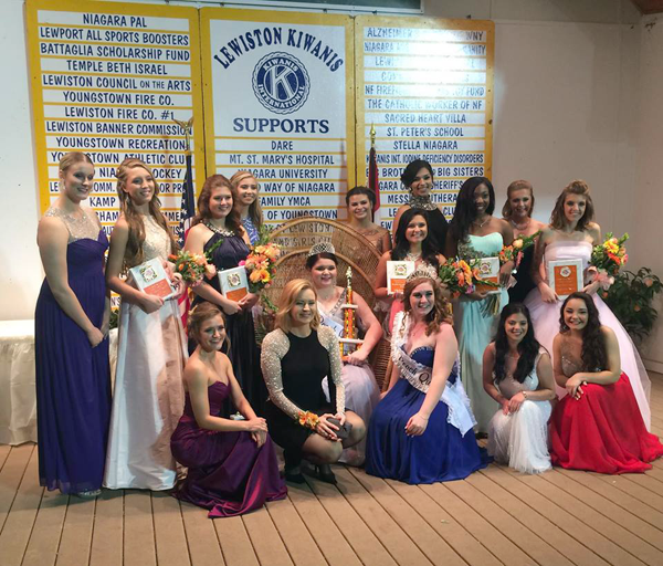 2016-17 Peach Queen Angelica Beiter is pictured with the 2015-16 Peach Queen Lindsey Clark, fellow contestants, and pageant emcee Maryalice Demler.