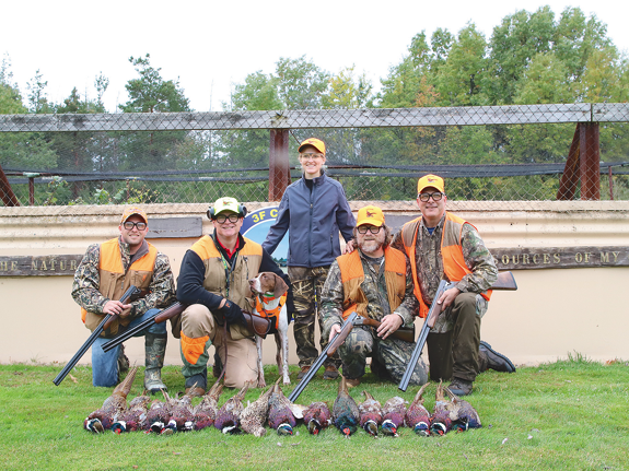 HAVA visitors, shown with their take of 15 pheasants bagged on the 3F fields.