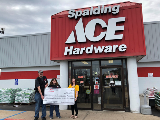 Pictured, from left: Spalding Ace Hardware employees Brice Regling and Amy Daily with Niagara Hospice Special Events Coordinator Allison Bolt.
