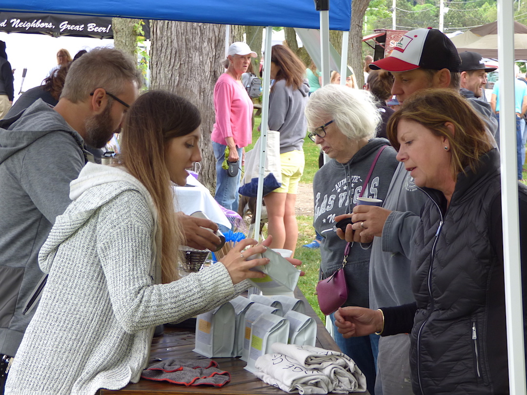 Pictured are scenes from the Lewiston Artisan Farmers Market's first summer at Academy Park.