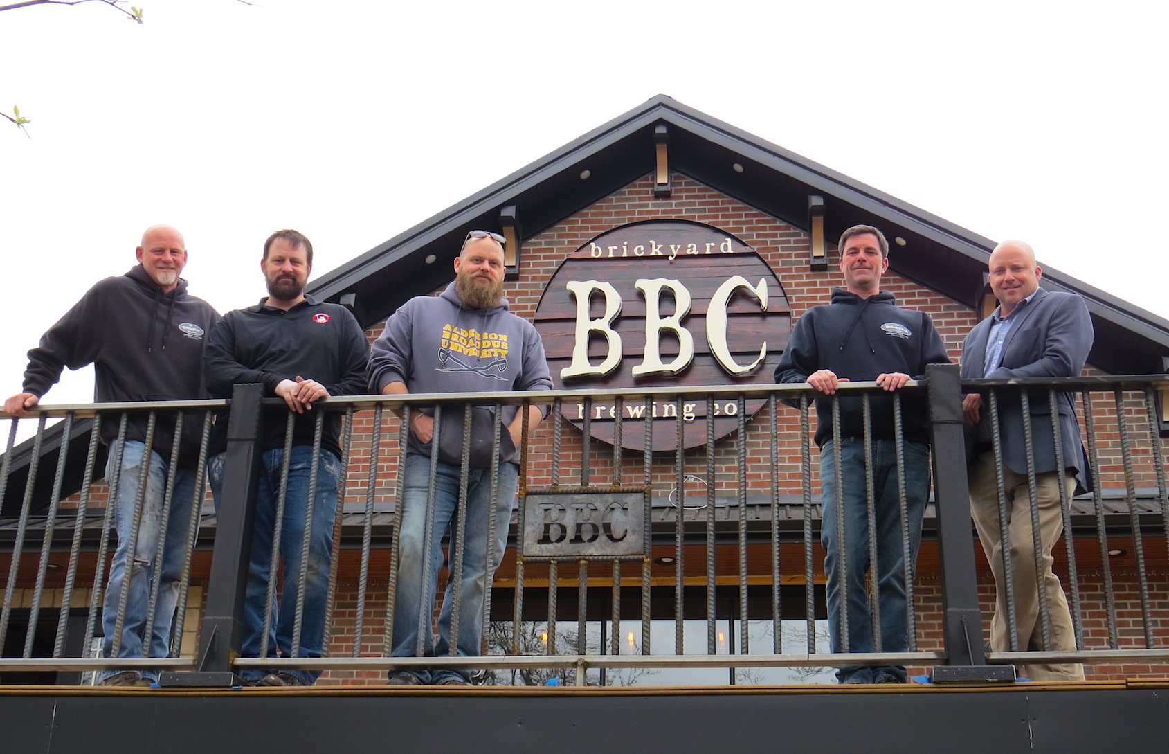 Pictured, from left, outside on The Brickyard Brewing Co. second-floor deck, are, from left: Eric Matthews, Steve Matthews, John Meteer, Ken Bryan and Jim Fittante. The restaurant is located at 436 Center St.