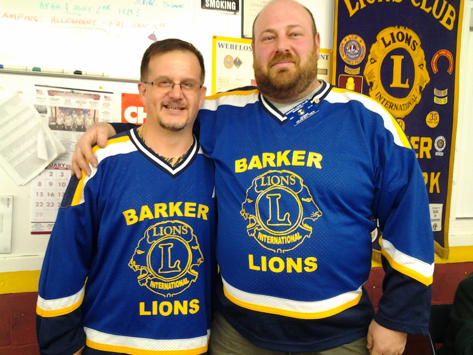 Barker Lions Club past presidents Scott Ecker and Kevin Bittner show off their Lions gear to show their enthusiasm for the annual cheese sale.