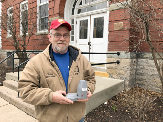 Village of Lewiston DPW Superintendent Terry Brolinski with a new water meter head. (File photo)