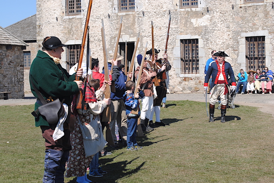 Thomas Thompson, right, of Hoisington's New York Rangers, portrays an officer of the Continental Army and organizes visitors to rebel from British control and fight as patriots. (Photo by Charlotte Clark)