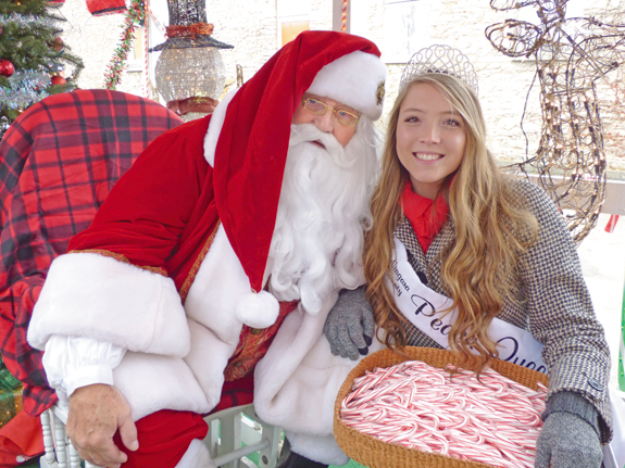 Santa Claus and 2017-18 Peach Queen Jamie Hagerty welcomed guests at last year's Christmas Walk. (File photo)