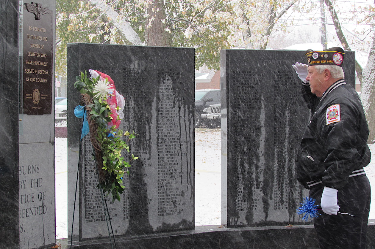Harry Raby salutes the memorial wreath.