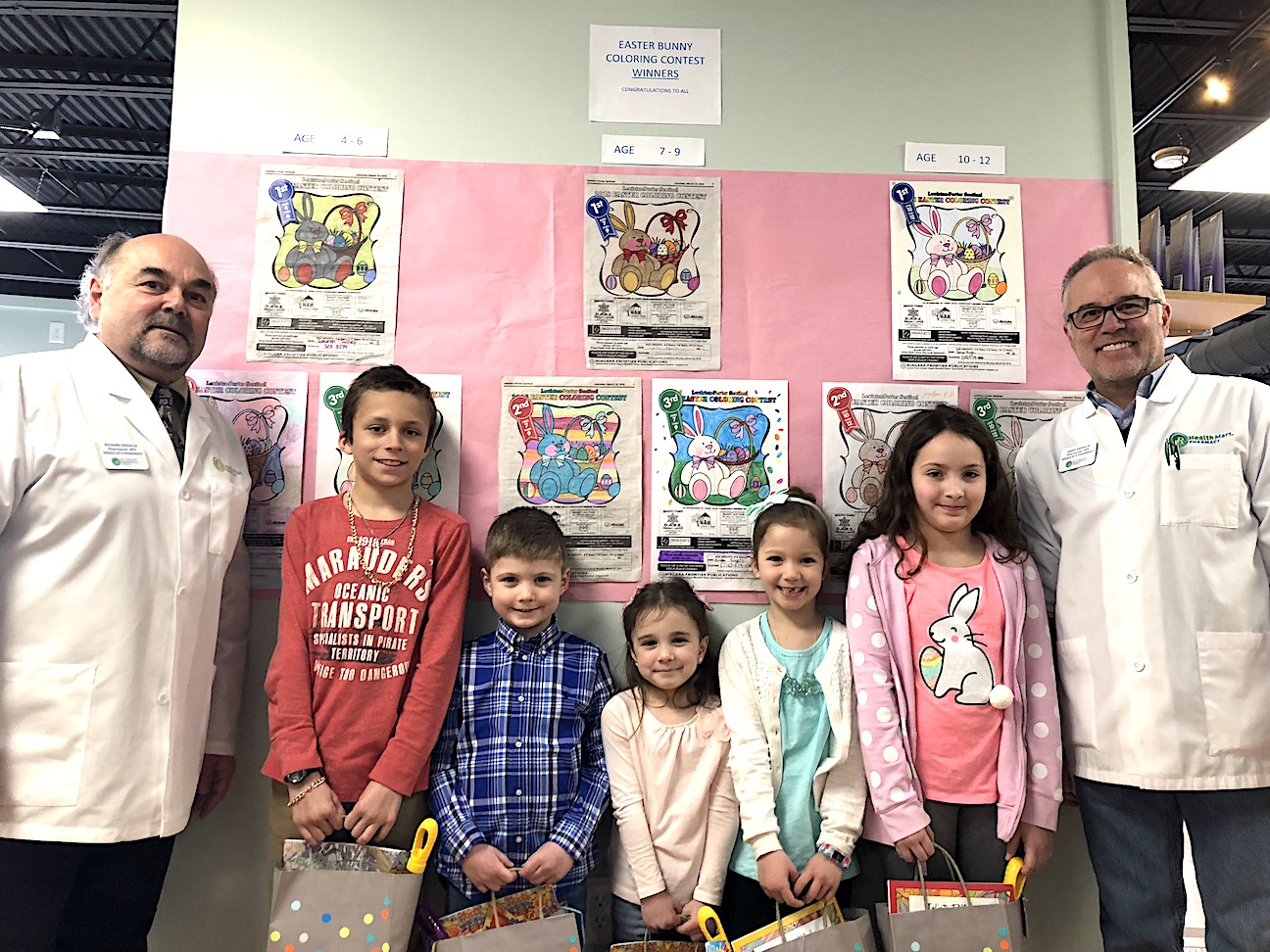 The DeGiulio brothers stand with a collection of coloring contest winners on Saturday.