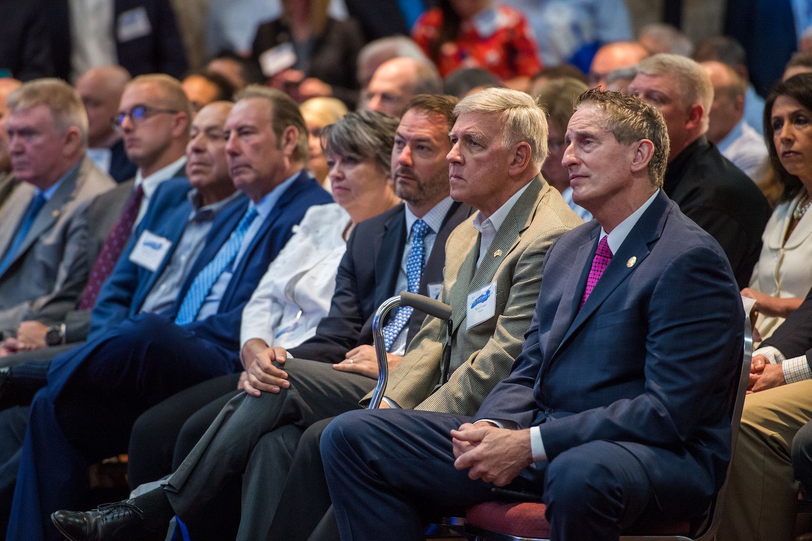 The audience listens as Gov. Andrew Cuomo holds a Lake Ontario Resiliency and Economic Development Initiative conference in Rochester.