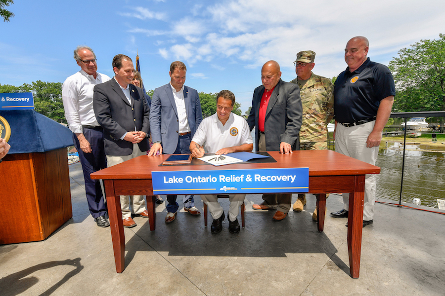 Gov. Andrew Cuomo signs legislation for $55 million toward homeowners and business affected by the flooding along the shores of Lake Ontario. (Photo courtesy of the governor's Flickr page)