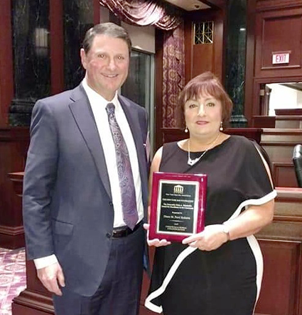 Diane Perri Roberts and Michael Schiavone at the recent awards ceremony at the U.S. District Court Southern District of New York in New York City. Schiavone, a partner at Lipsitz Green Scime Cambria, and chairman of the firm's business and corporate practice, spoke at the ceremony and presented the award to Perri Roberts.