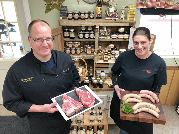 Frank and Rachel Dispenza show off some of the products sold inside Dispenza's Meat Market and set to be offered this summer at the new artisan market in Academy Park.