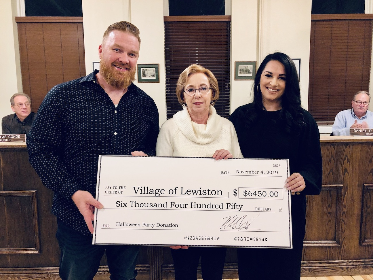 Michael Carroll and his girlfriend, Brittney Page, present a donation to Village of Lewiston Mayor Anne Welch prior to Monday's Village Board work session.