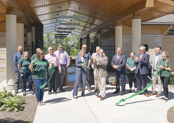State Parks Commissioner Rose Harvey cuts the ribbon Thursday on the new, $2.7 million bathhouse at Old Fort Niagara State Park. (Photo by Terry Duffy)