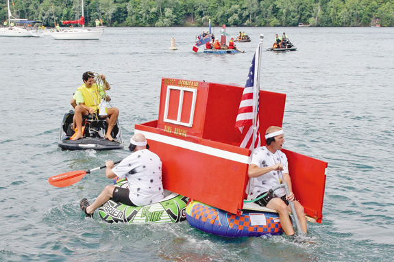 Participants enter the river at the Lewiston docks for the 2016 Great Contraption Race. IHTAF officials announced the race will take place in June on the Buffalo River as part of an overall move to Buffalo. (File photo by Glenn Clark)