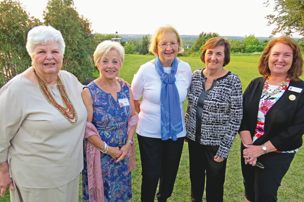 Garden Club leaders Jacquie Lodico, Barb Carter, Marianne Gittermann and Sharon Low stand with District 8 Director Debbie Braun.