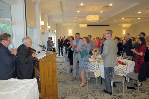 Dr. Melvin B. Dyster receives a standing ovation Wednesday during the HART Interfaith awards celebration.