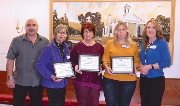 HART Executive Director Lisa Lannon (right) recognized three long-term caregivers who have been affiliated with the service agency since the 1980s. Shown, from left, are MaryLou Schultz, RN; Marilyn DelValle, PCA; and Julie Hoffman, CAN. Joining them at left is HART board member Vanik Aloian, a Summer of '69 All Star Band member.