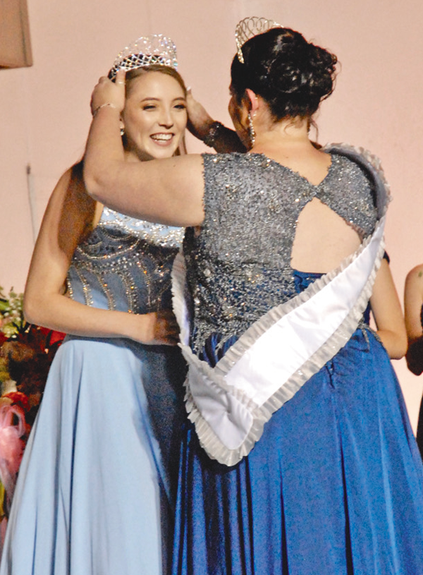 Jamie Hagerty was crowned Peach Queen by her predecessor, Angelica Beiter, on Sunday, Sept. 10. (Photo by Robin Clark)