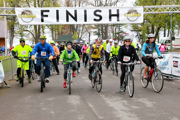 Riders in the fourth annual Hospice Gran Fondo cross the finish line at Krull Park in Olcott. The ride featured three routes that travelled through the Niagara Wine Trail.