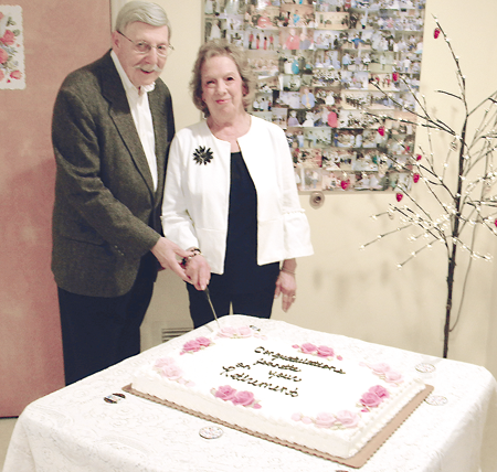 Terry and Jeanette Collesano and the special retirement cake in her honor.