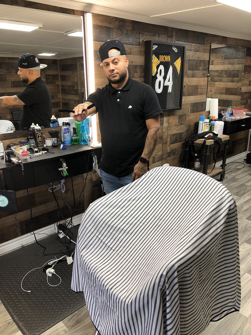 Will Cruz is shown working inside the J-Cruz Barbershop at 748 Center St., Lewiston.