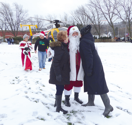 The Niagara River Region Chamber of Commerce kicks off the holiday season with the Lewiston Christmas Walk. Santa is shown, upon flying into Academy Park, greeting dignitaries and proceeding down Center Street. (File photos)