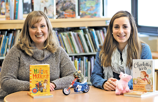 School librarians Heather Zielinksi of the Primary Education Center and Rebecca Metz of the Intermediate Education Center with this year's `One District, One Book` selections: `The Mouse and the Motorcycle` by Beverly Cleary and `Charlotte's Web` by E.B. White. (Submitted photo)