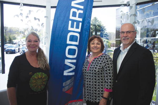 In the photo, from left: LCA Artistic Director Eva Nicklas, Rykaszewski and Modern Corporation CEO Michael P. McInerney.