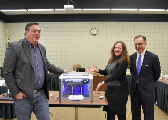 Jim Sheehan, Lewiston-Porter Board of Education President Jodee Riordan and Lewiston-Porter Superintendent Paul Casseri stand next to a donated printer.