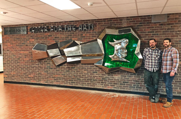 Dan Buttery (left) and Michael Hibbard stand next to the artwork they created at Lewiston-Porter High School.