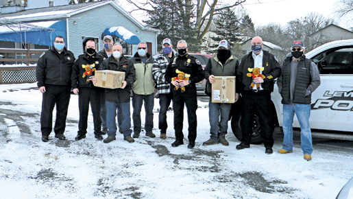 Police officials shown holding their Tommy Moose gifts are Niagara County Sheriff Mike Filicetti (at left), Lewiston Police Chief Frank Previte (center) and Youngstown Police Chief Mike Schuey (right).
