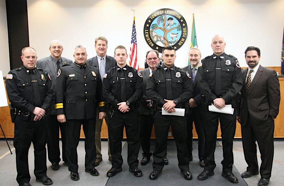 Lewiston Police Department officers join with elected leaders.