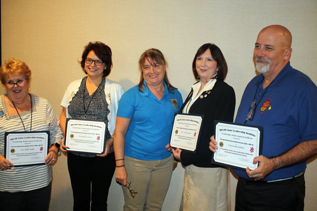 Pictured, from left: Sheila Zuhlke, Regina Cecconi, District Gov. Sharon Battaglia, Ann Foster Akin and Jeremy Schnurr.